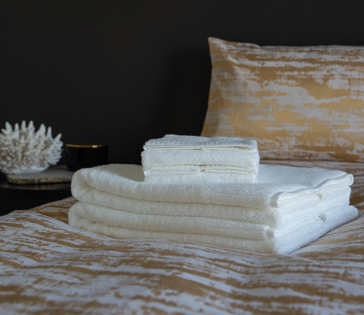 feature-s32-organic-cotton-japanese-towels-on-bed-product